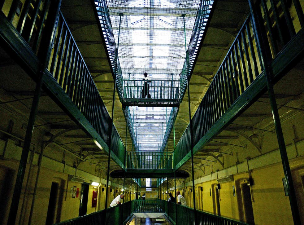 Prisoners at HMP Pentonville walk through an atrium