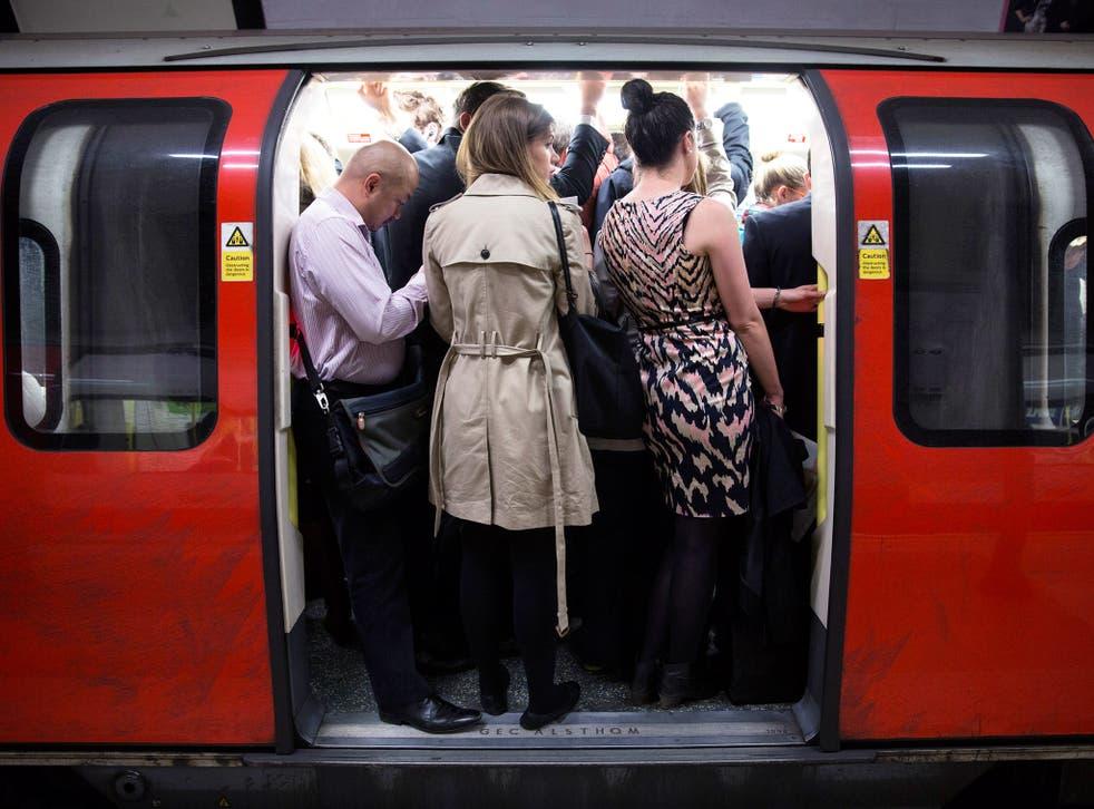 Underground passengers squeeze onto a train (Getty)