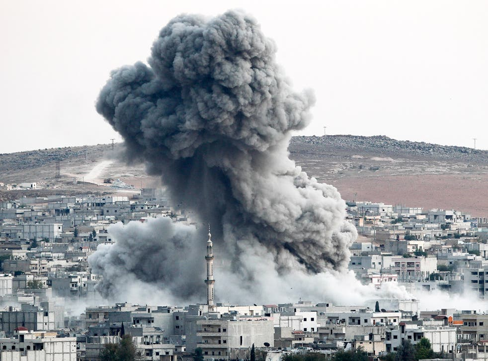 Smoke rises following an air strike by the US-led coalition in Kobani, last October