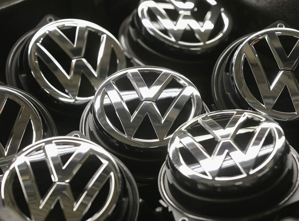 Volkswagen trunk ornaments bearing the VW logo lie next to the Golf VII assemly line at the Volkswagen factory on February 25, 2013 in Wolfsburg, Germany.