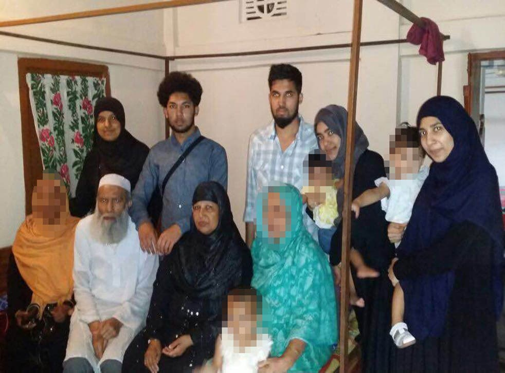 21-year-old Rajia Khanom (back row, far left) was spoken to by police at Heathrow