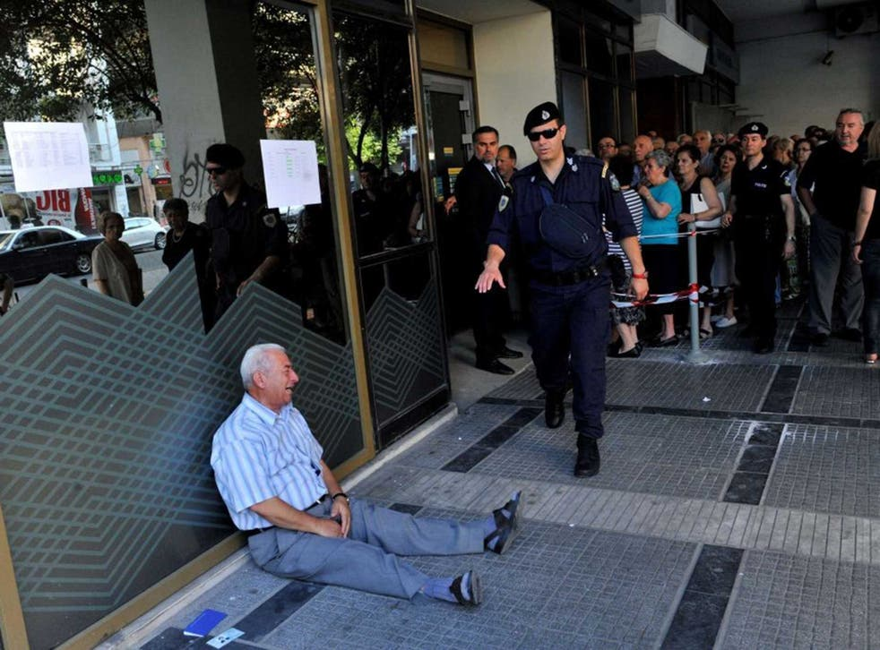 The unidentified man weeps outside the bank's branch