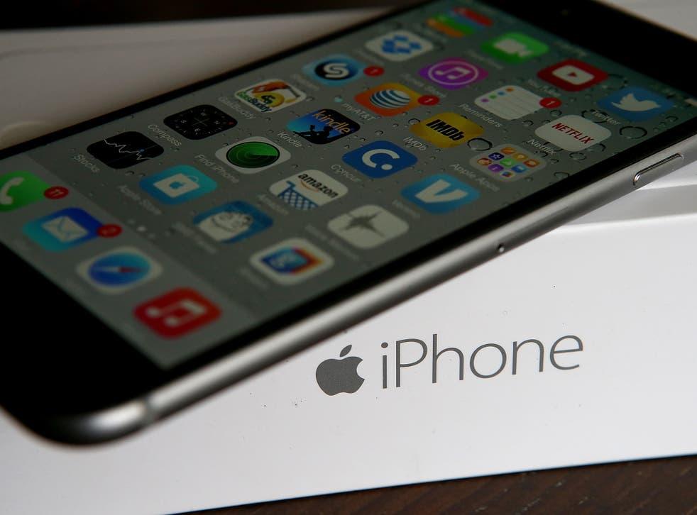 An Apple iPhone sits on a box on January 27, 2015 in San Anselmo, California