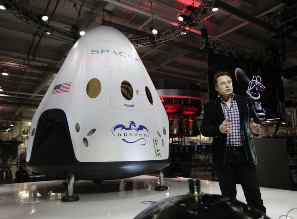 Elon Musk with a SpaceX rocket. Will his gamble on commercial space transport pay off?