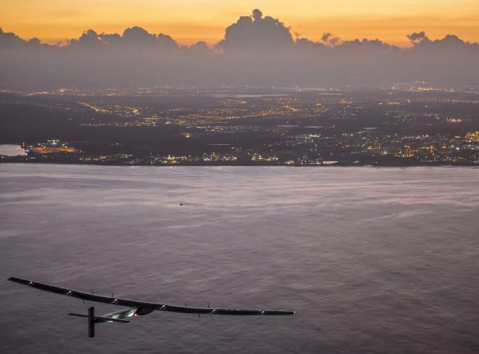 The Solar Impulse 2, powered by the sun's rays, approaches Kalaeloa Airport near Honolulu on Friday