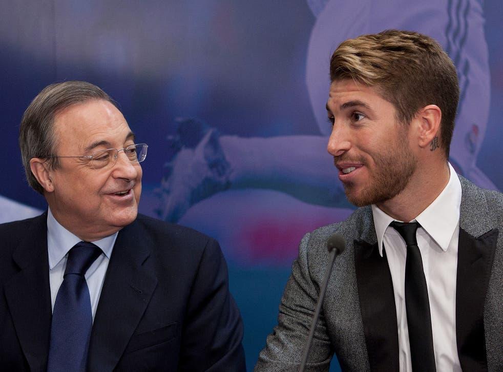 Real Madrid owner Florentino Perez alongside Sergio Ramos