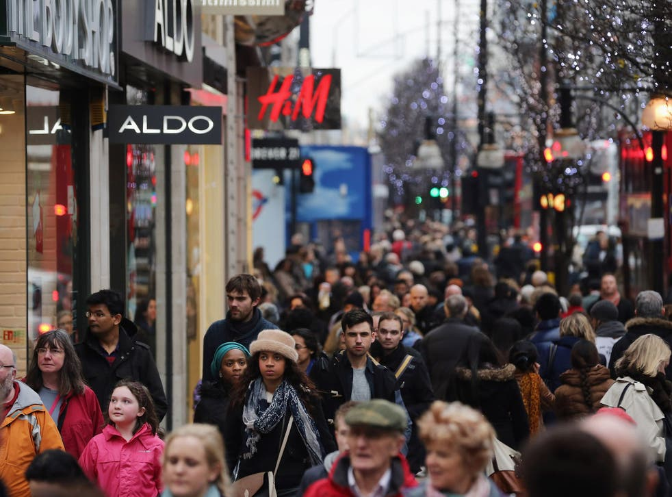 Shoppers make their way down Oxford Street on 24 December 2012 in London, England