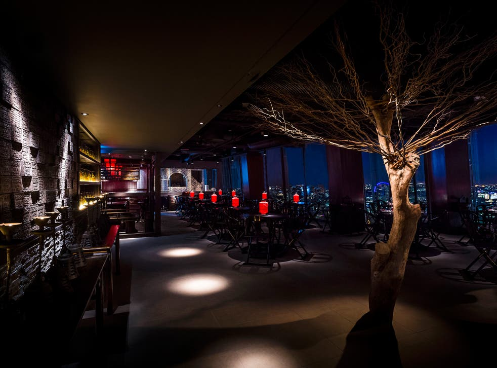 Inside Hutong, it's all sexy gloom, with dark-wood panelling lit with red lanterns