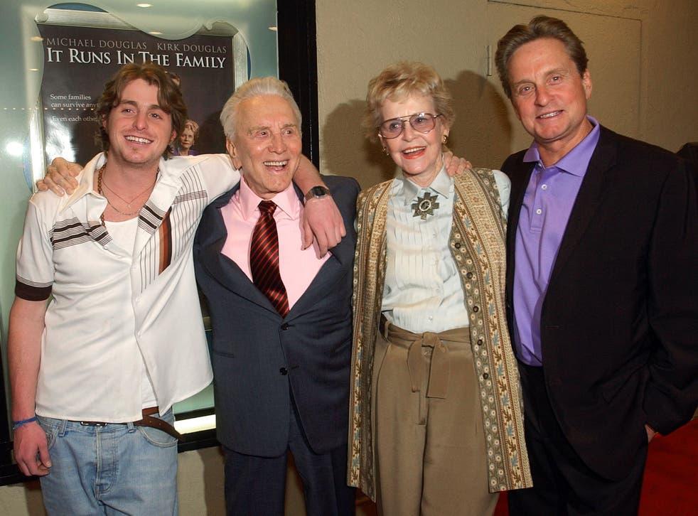 Kirk Douglas poses with his ex-wife Diana Douglas, their son Michael Douglas, and Michael's son Cameron Douglas