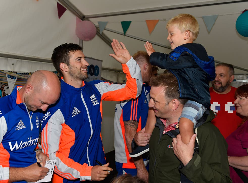 Adam Lyth, left, and Mark Wood meet the fans at Cardiff Castle ahead of the first Test