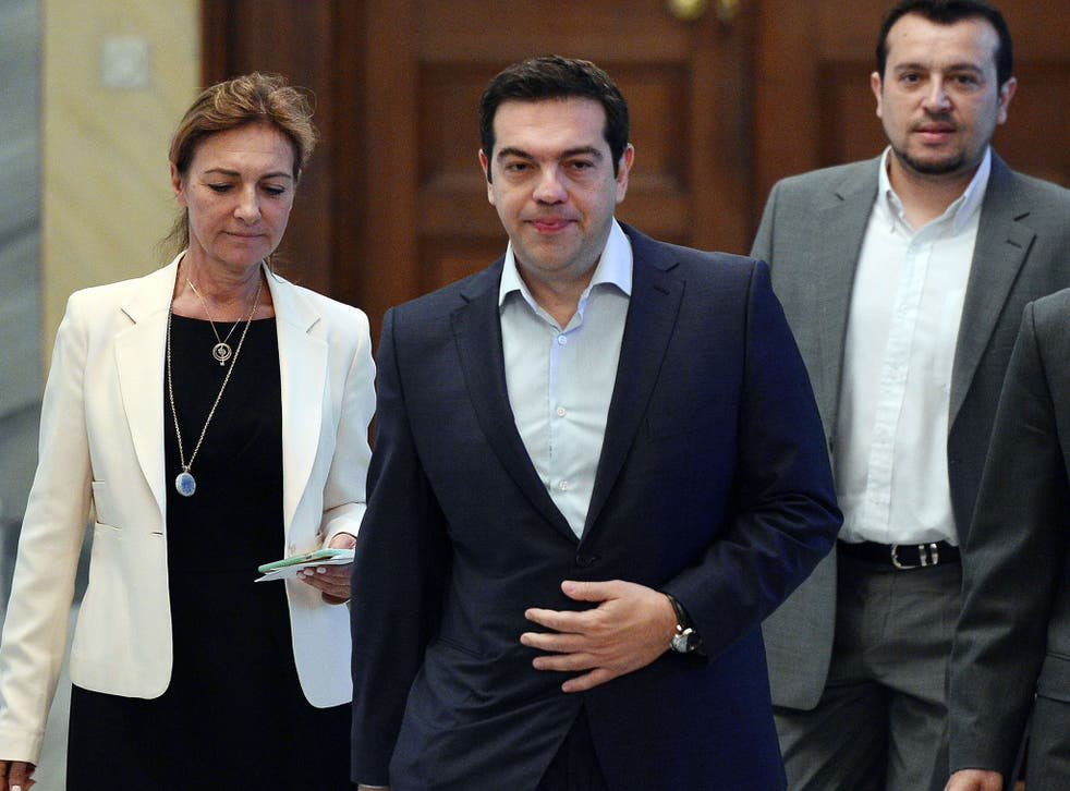 Greek Prime Minister Alexis Tsipras arrives for his meeting with the Greek political leader and the Greek President at the presidental palace in Athens