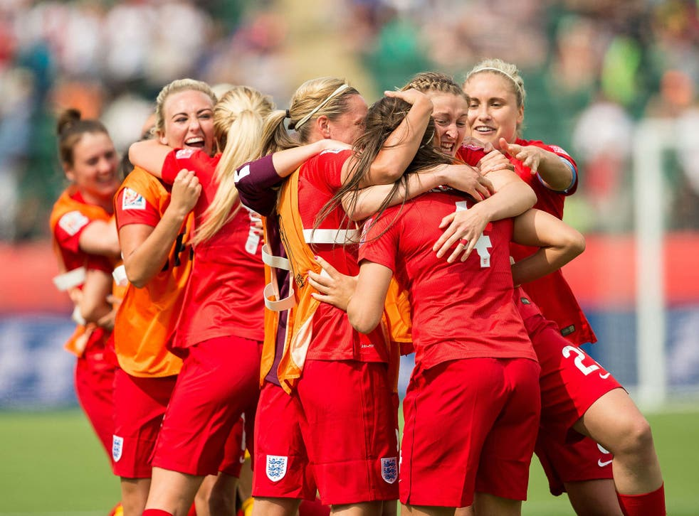 England's players celebrate Fara Williams' goal during extra time of their bronze medal match against Germany at the FIFA Women's World Cup in Edmonton, Alberta