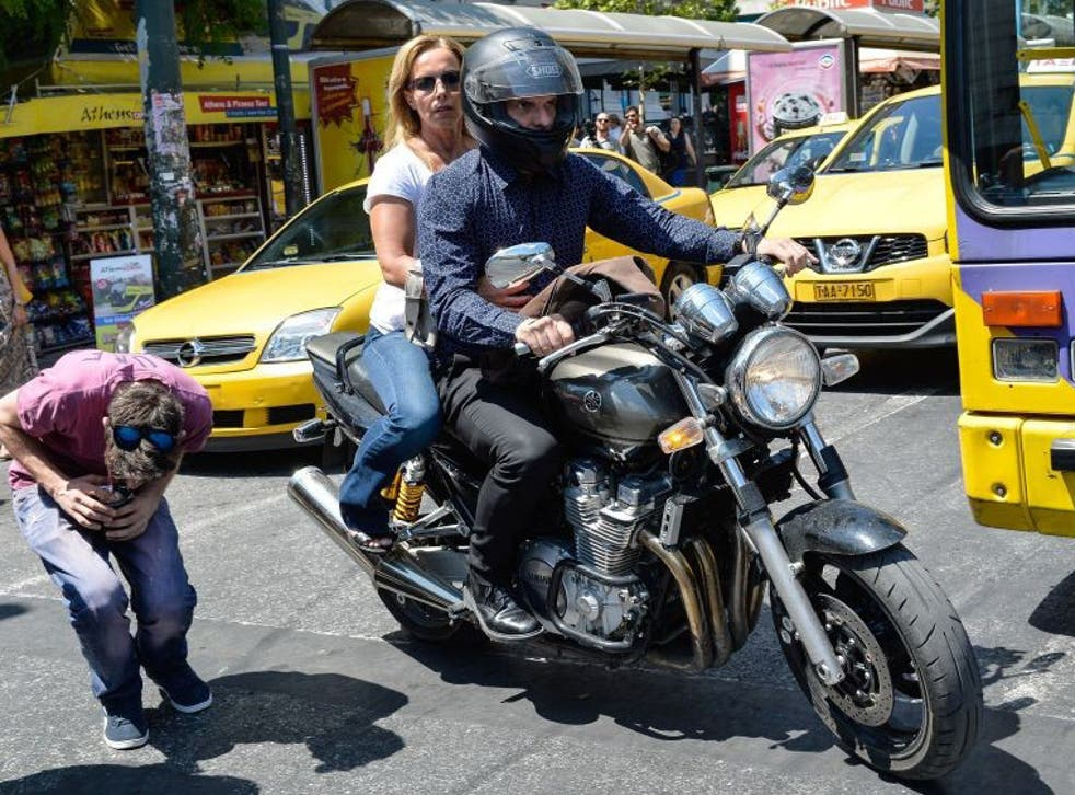 Greek finance minister Yanis Varoufakis leaves the finance ministry for good with his wife Danae Stratou