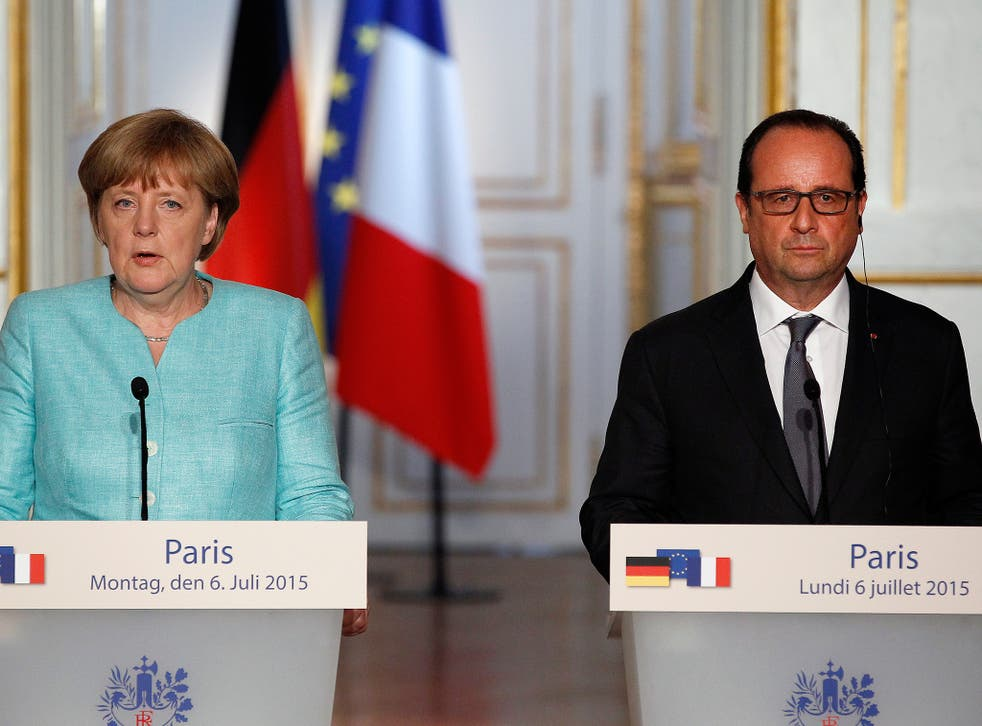 French President Francois Hollande and German Chancellor Angela Merkel during a press conference after their meeting at the Elysee Palace. The two leaders met to discuss the situation concerning the Greece in the European Union