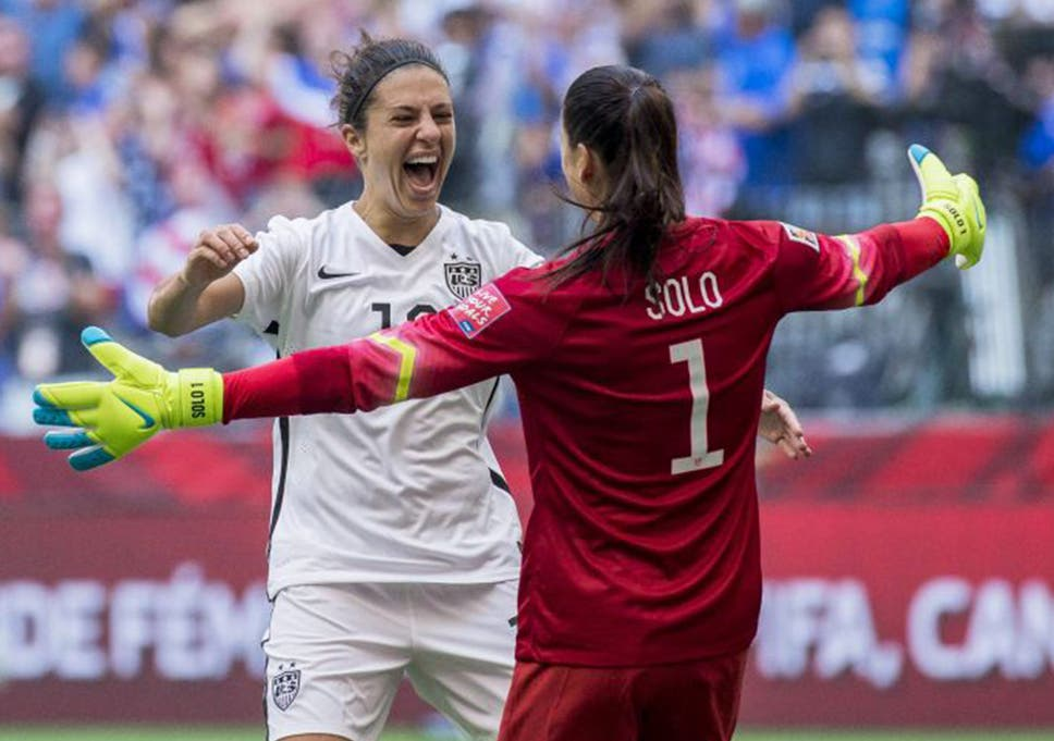 4966dbb9850 Carli Lloyd celebrates with US goalkeeper Hope Solo after the final victory