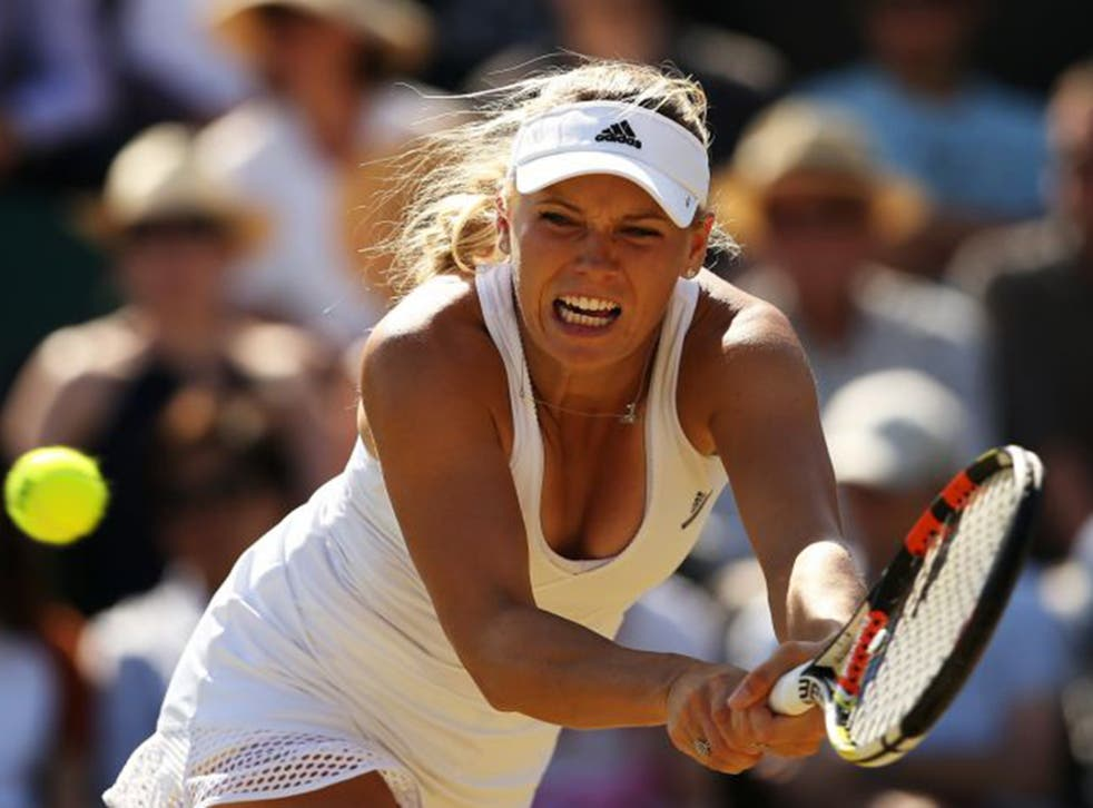 Caroline Wozniacki on her way to defeat against Garbine Muguruza
