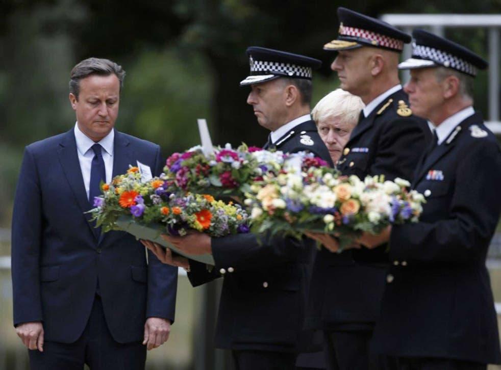 David Cameron and London Mayor Boris Johnson watch the servicemen lay wreaths in Hyde Park
