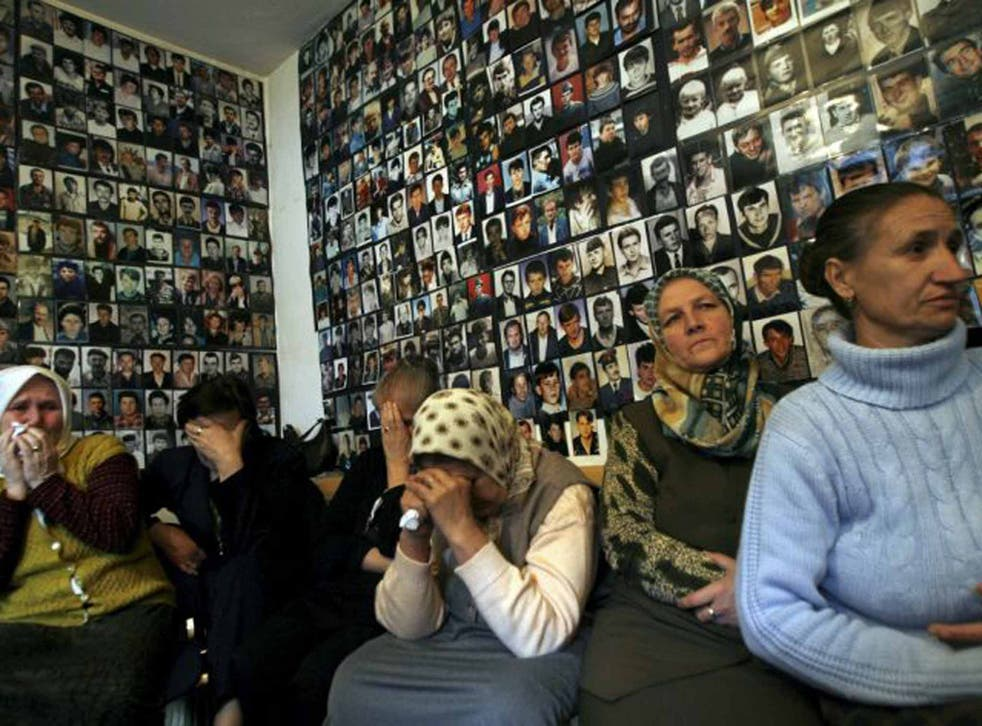Gone but not forgotten: women from Srebrenica with pictures of their missing loved ones