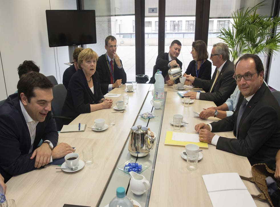 Greek Prime Minister Alexis Tsipras, front left, at Tuesday's emergency eurozone summit in Brussels