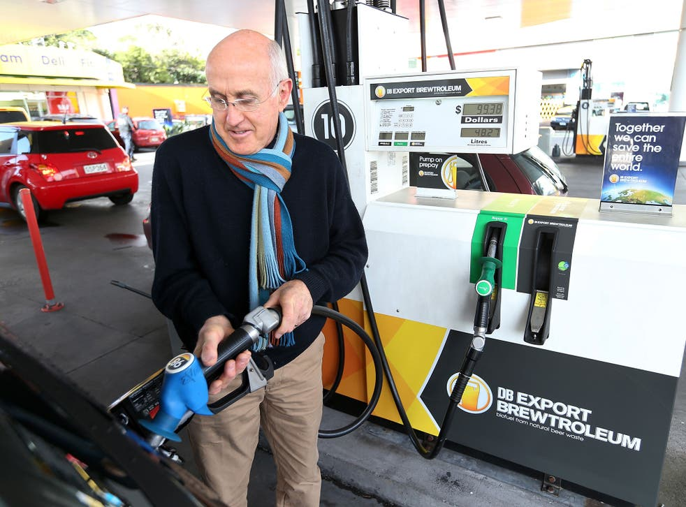 A driver fills up his car with Brewtroluem biofuel in New Zealand