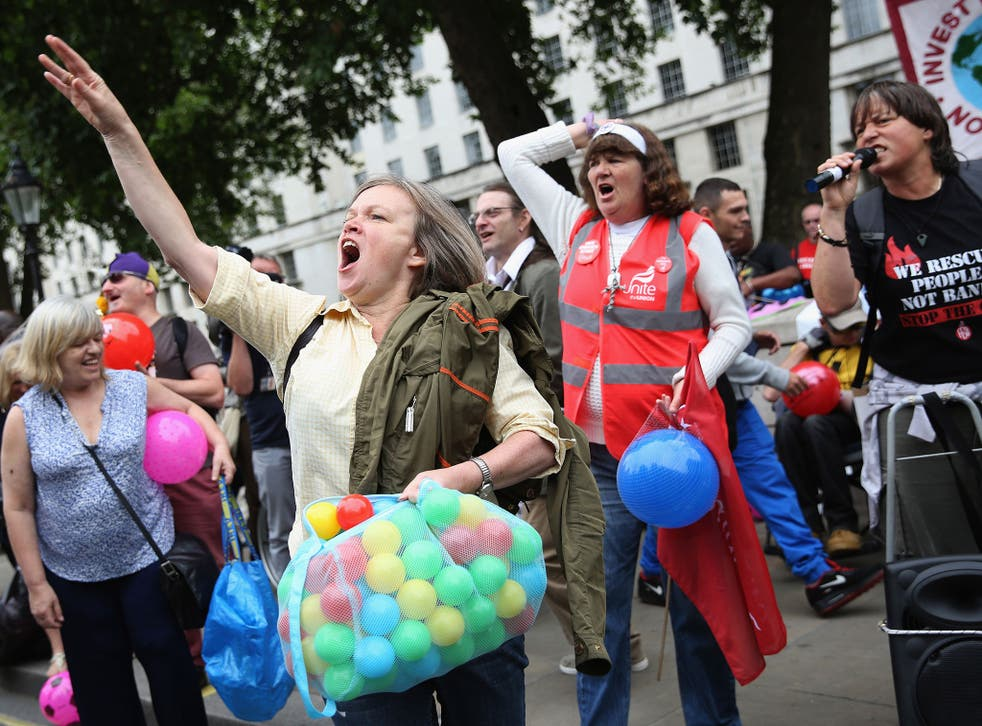 Anti-austerity protesters shout slogans outside Downing Street as the Chancellor of the Exchequer George Osborne left 11 Downing Street