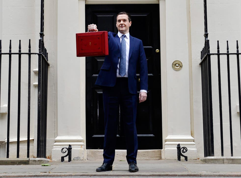 George Osborne holds up the red briefcase outside No 11 Downing Street