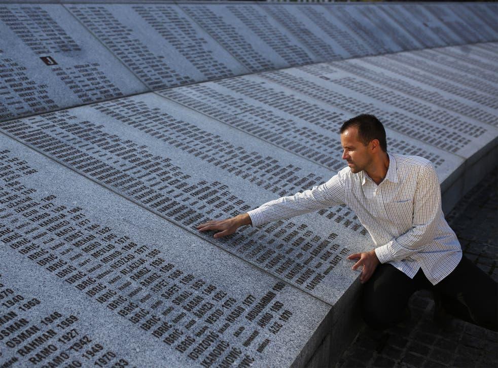 A mourner at the Srebrenica Genocide Memorial