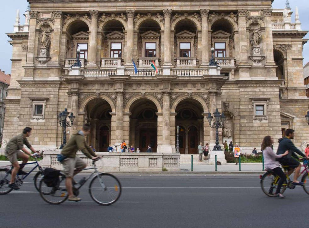 Take in city icons such as the Opera House by bike