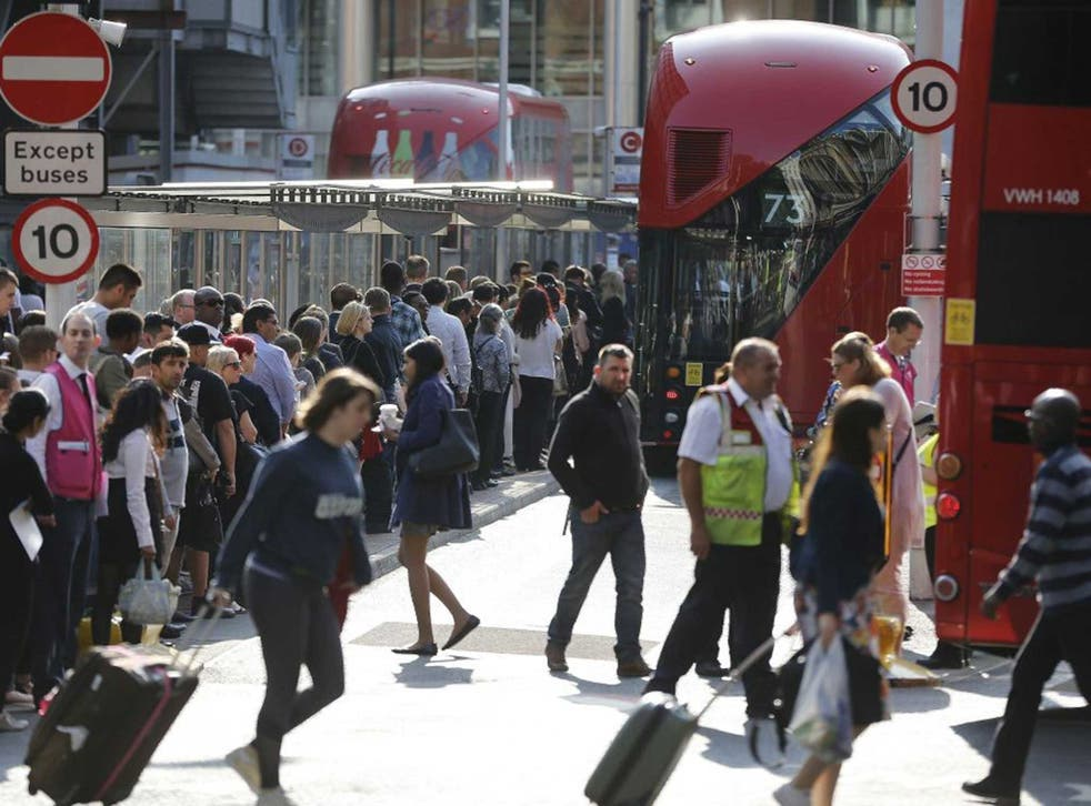 Commuters queue for buses as tube drivers are on strike in London