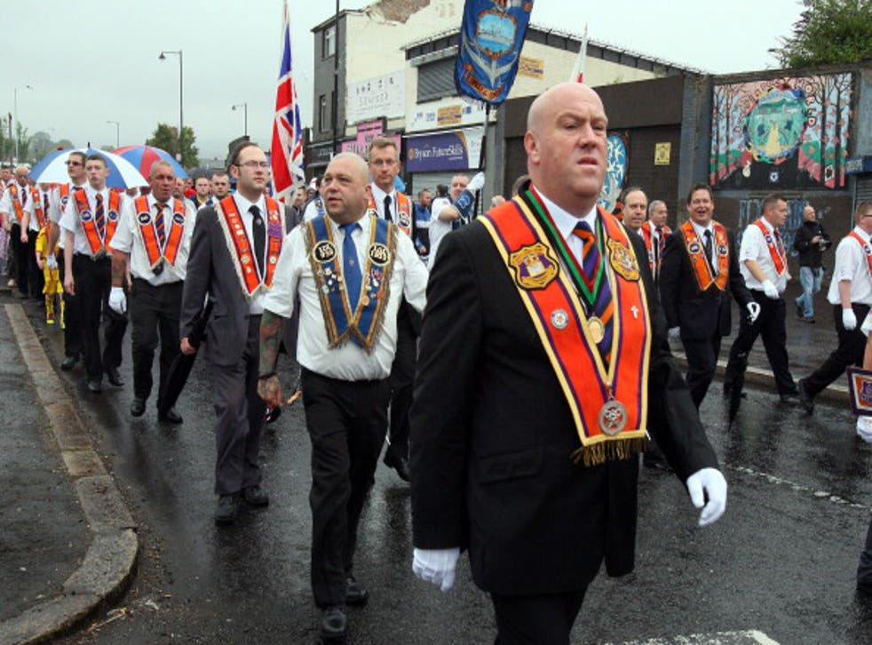 Loyalists of the Orange Order march past the nationalist Ardoyne area of North Belfast, in Northern Ireland, on July 12, 2014