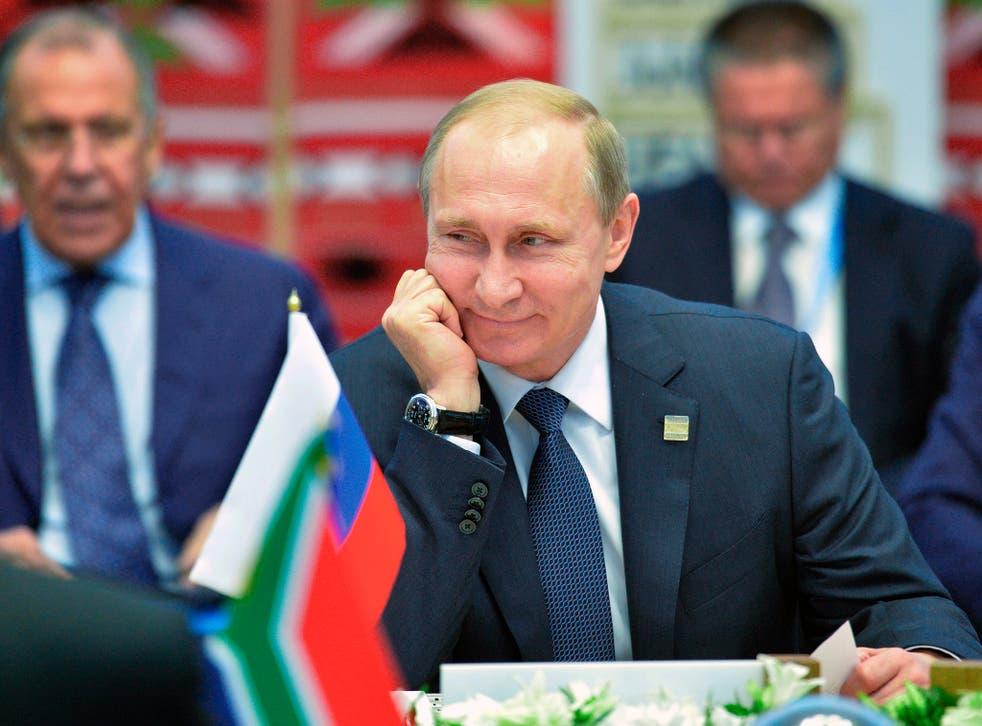 Russian President Vladimir Putin smiles during BRICS (Brazil, Russia, India, China, South Africa) summit in Ufa, Russia