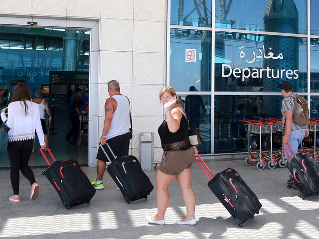 Tourists queue to leave Tunisia at the Enfidha international airport