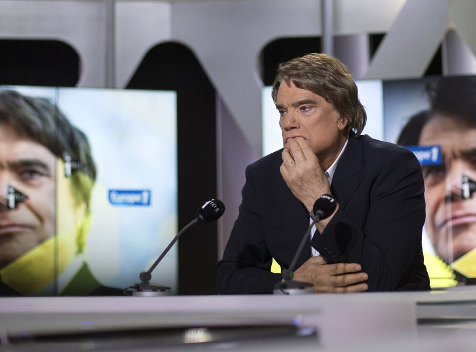 Embattled tycoon Bernard Tapie attends a broadcasted debate on French news channel iTele