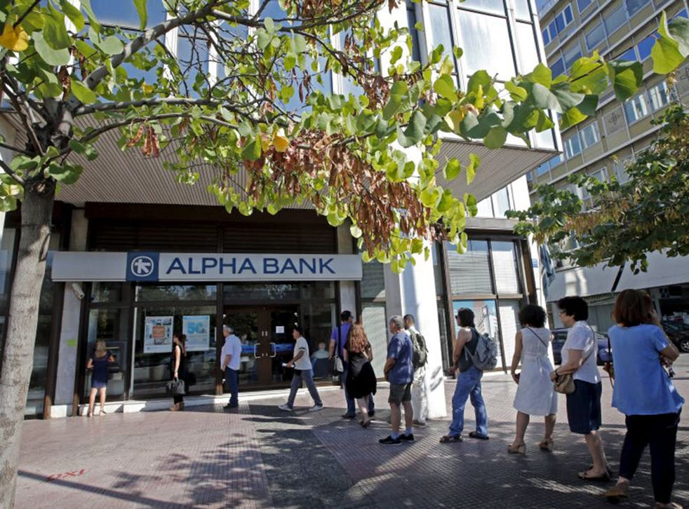 People queue at ATMs in Athens last week, but would they be better off without them?