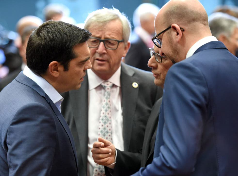 Greek Prime Minister Alexis Tsipras, left, speaks with, from left, European Commission President Jean-Claude Juncker, French President Francois Hollande and Belgian Prime Minister Charles Michel during a meeting of eurozone heads of state at the EU Counci