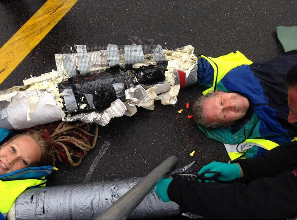 Activists chained themselves to the tarmac at Heathrow with arm locks