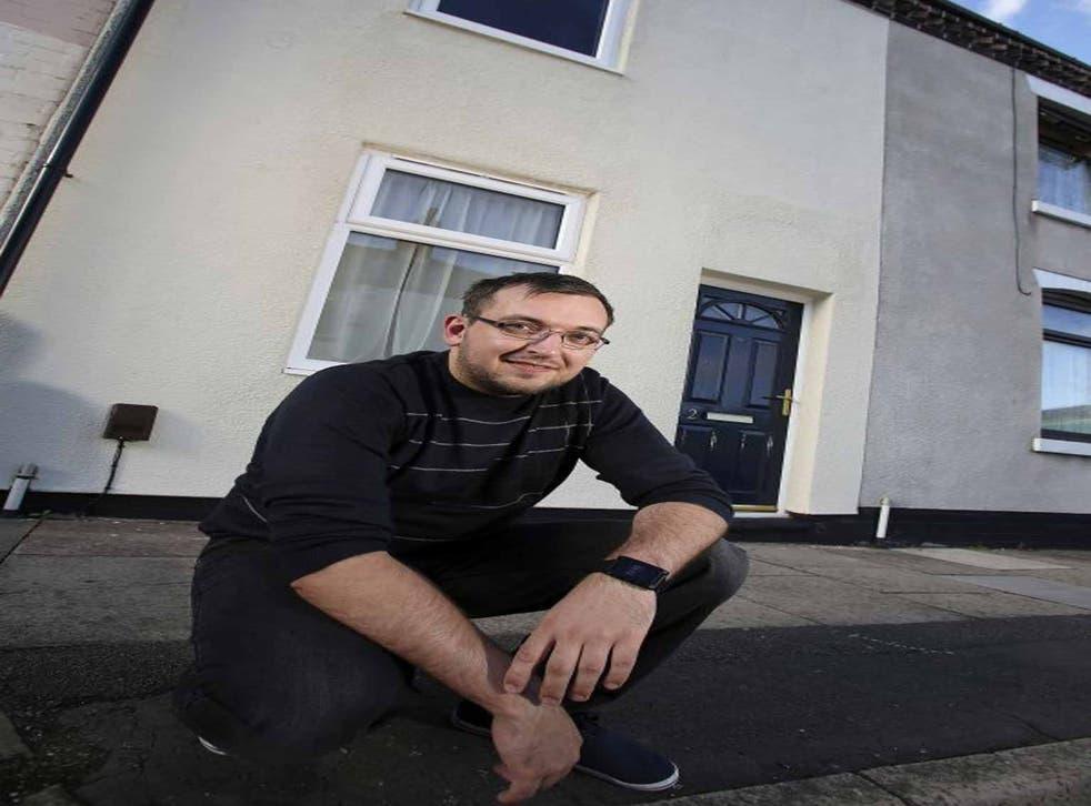 Gavin Pierpoint outside his £1 house in Stoke (UNP)