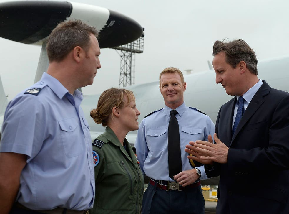 David Cameron with Flight Lieutenant Sarah Vamplew at RAF Coningsby in Lincolnshire. The Prime Minister faces a Commons vote on easing the fox-hunting ban