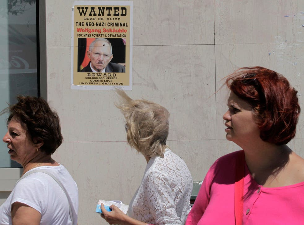 A poster depicts the German Finance Minister Wolfgang Schäuble as a Neo-Nazi in Athens