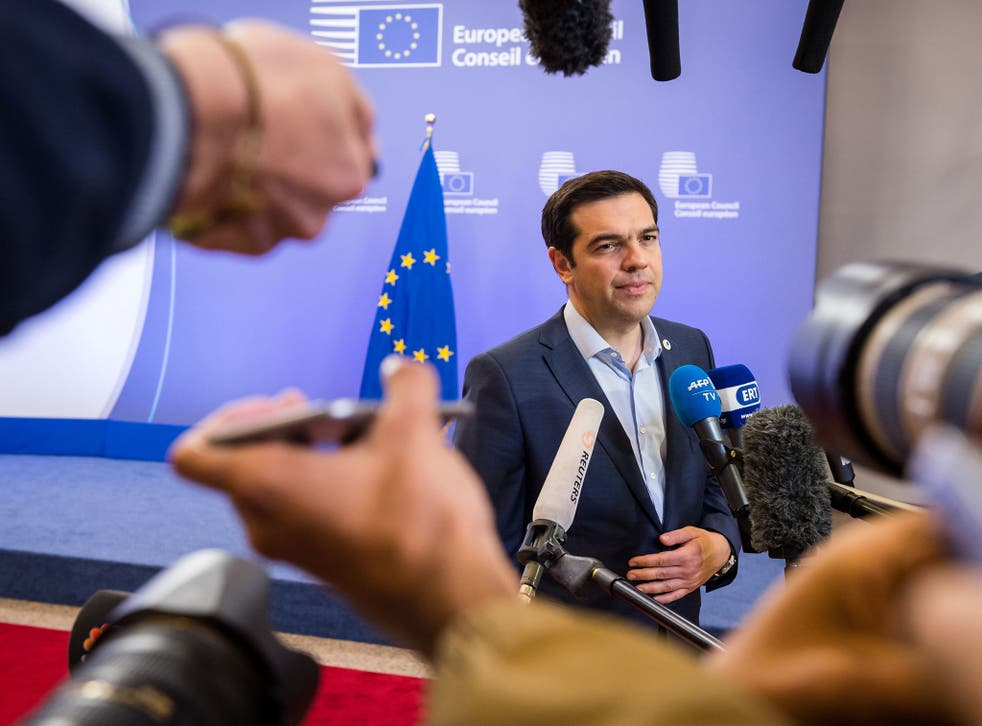 Greek Prime Minister Alexis Tsipras speaks with the media after a meeting of eurozone heads of state at the EU Council building in Brussels