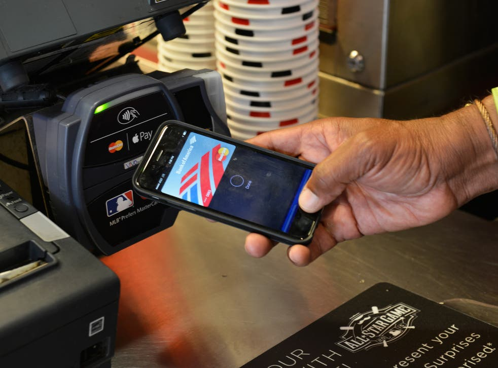Ozzie Smith uses Apple Pay at the Home Run Derby at Great American Ball Park on July 13, 2015 in Cincinnati, Ohio