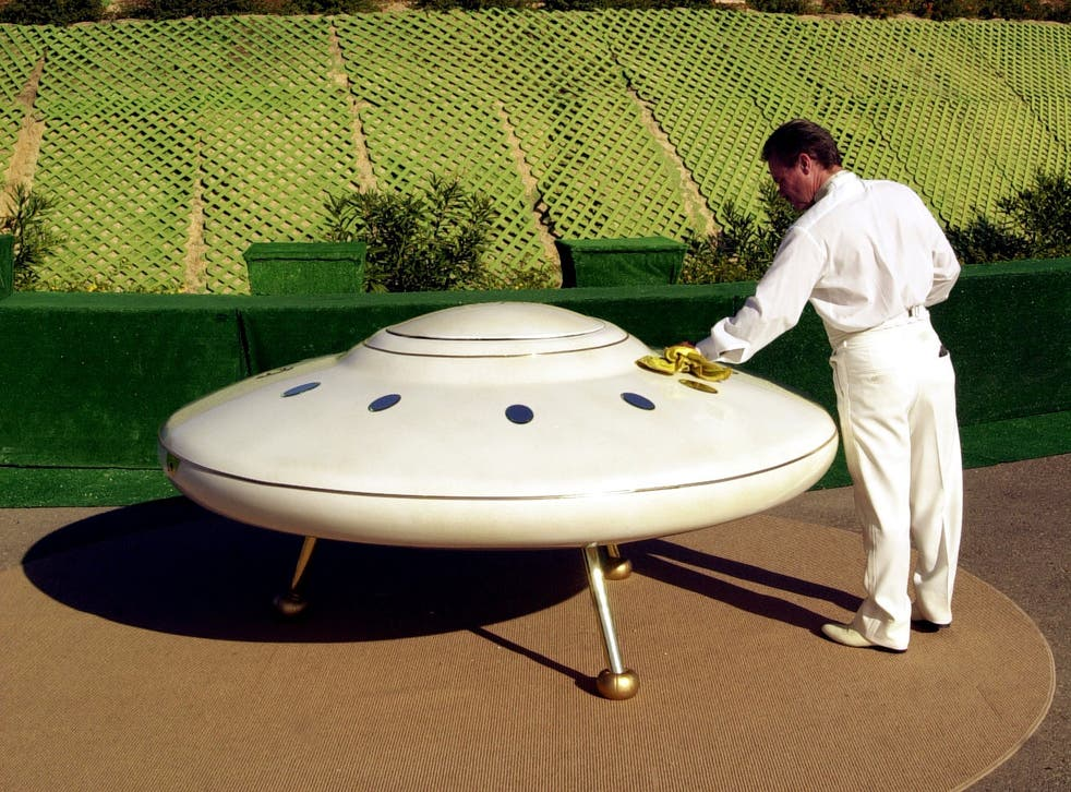 A man polishes his flying saucer in California