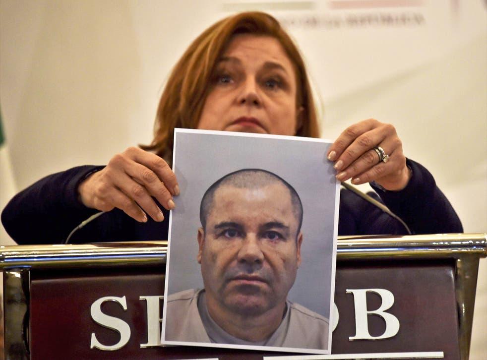 Mexico's Attorney General Arely Gomez shows the press a picture of Guzman