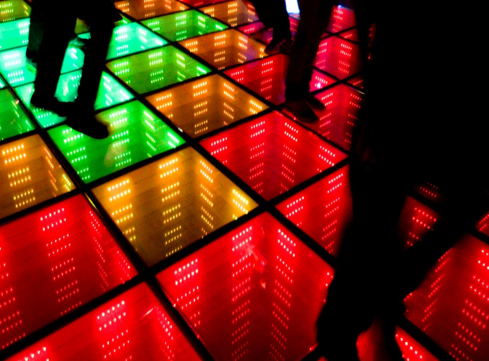 Best foot forward: revellers make the most of a dance floor lit by their steps