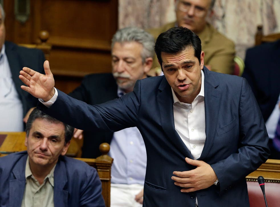 Prime Minister, Alexis Tsipras, delivers a speech during the meeting in the Greek parliament
