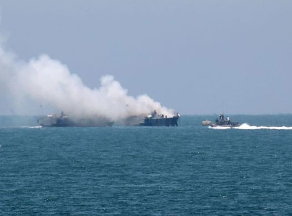 Smoke rises from the Egyptian navy ship after an apparent rocket attack purportedly launched by Isis-linked militants