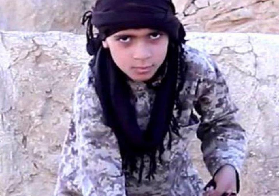 Isis video shows young boy beheading Syrian soldier near
