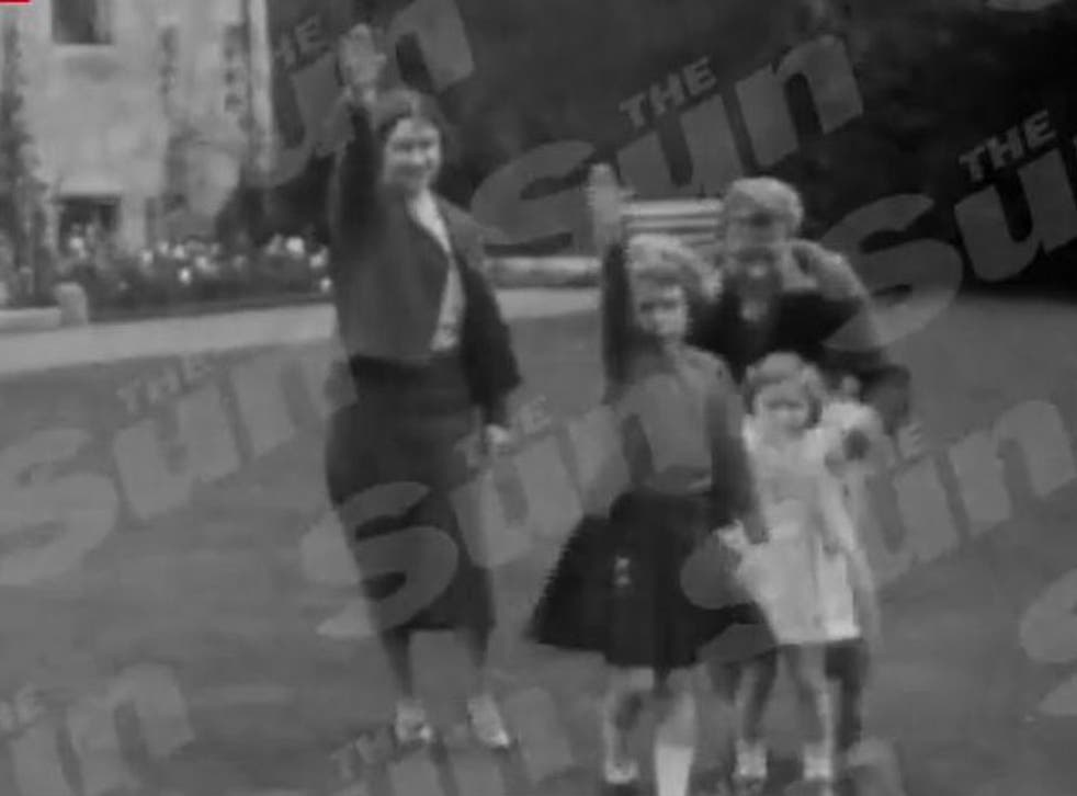 The footage appears to show Princess Elizabeth, her mother and uncle performing the salute