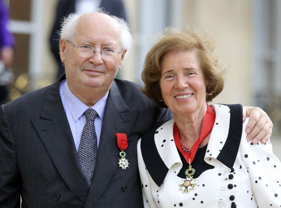 French famed Nazi hunter Serge Klarsfeld poses with his wife Beate, as they leave the Elysee Palace in Paris, after being awarded with the Legion of Honor medal by French President Francois Hollande.