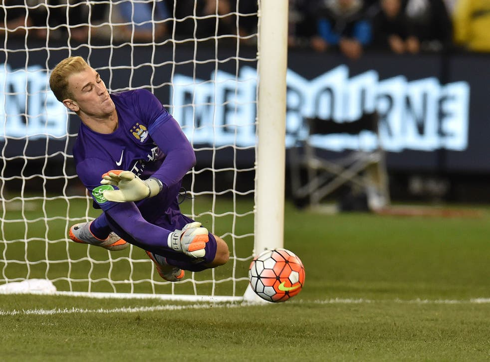 Joe Hart saves a penalty in a pre-season shoot-out victory for Manchester City over Roma
